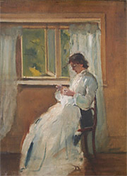 Woman in white seated before a window